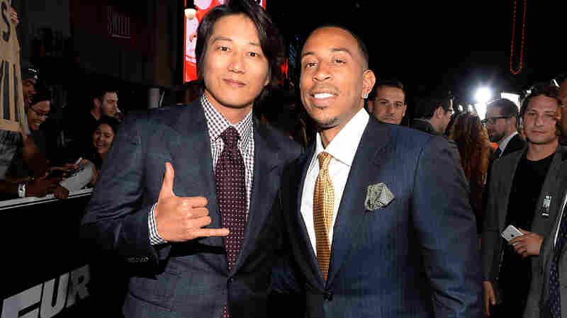 Furious 7 has hit the $1 billion worldwide box-office mark, two days faster any other film. Earlier this month, stars Sung Kang, left, and Ludacris attend the film's Los Angeles premiere.
