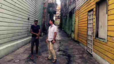 Former gang member Ricky James (left) and developer K.C. Hardin in Casco Viejo, the historic old city.