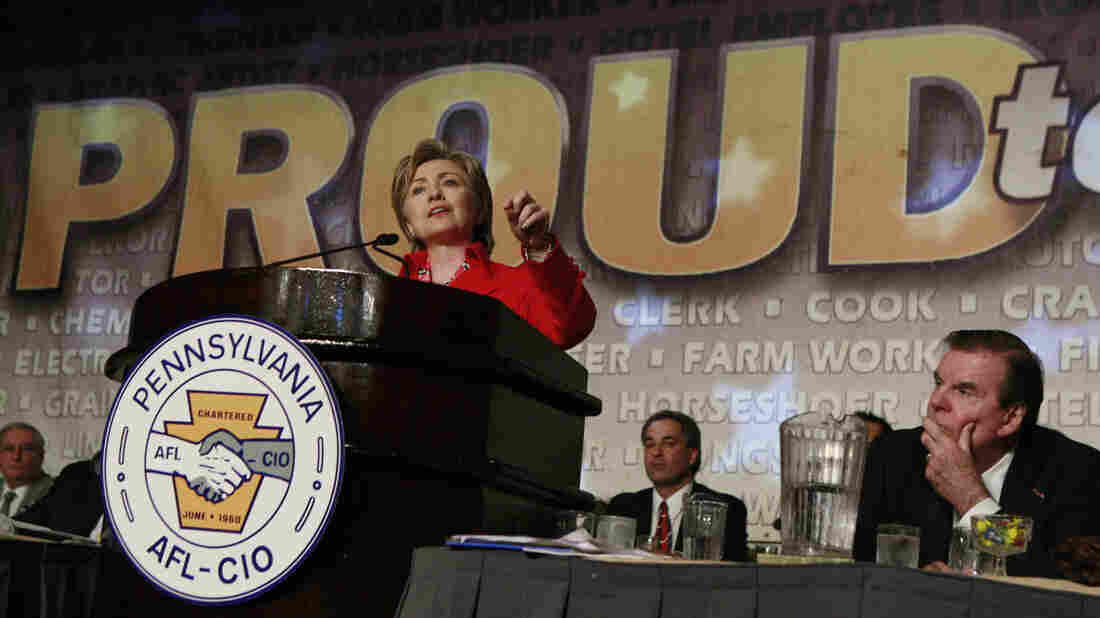 Hillary Clinton addresses the Pennsylvania AFL-CIO three weeks before the Democratic primary contest against Barack Obama. Seated at right is Pennsylvania AFSCME President Gerald W. McEntee.
