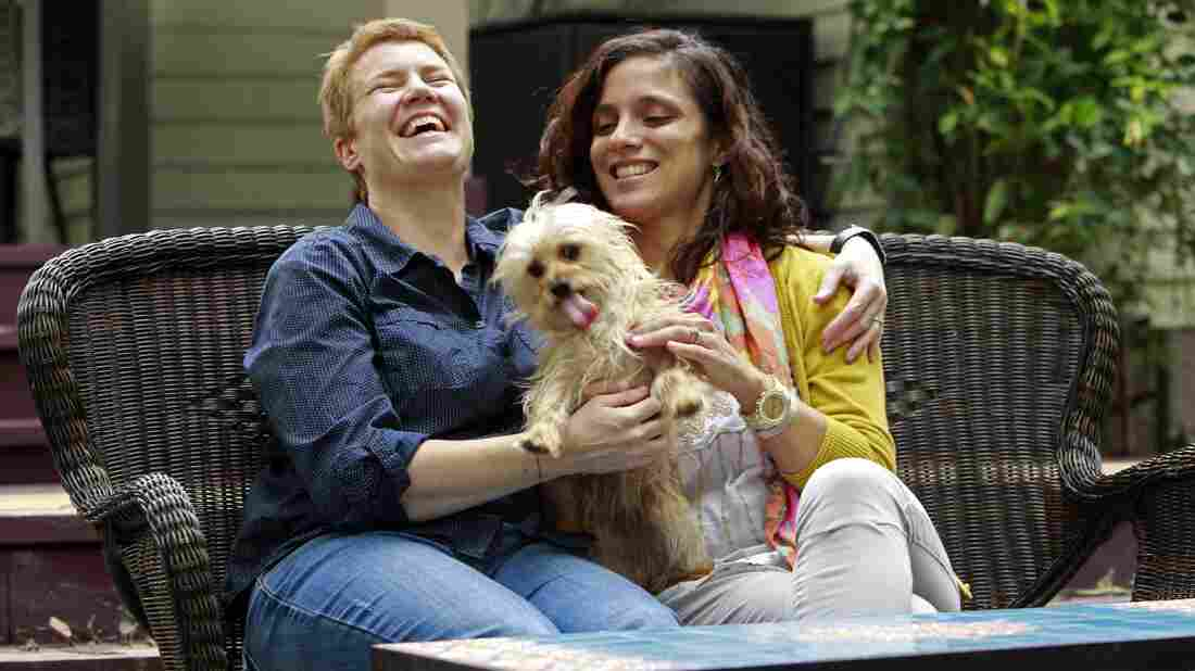 Veterinarians Sophy Jesty (left) and Val Tanco with their dog, Biscuit, at home in Knoxville, Tenn.