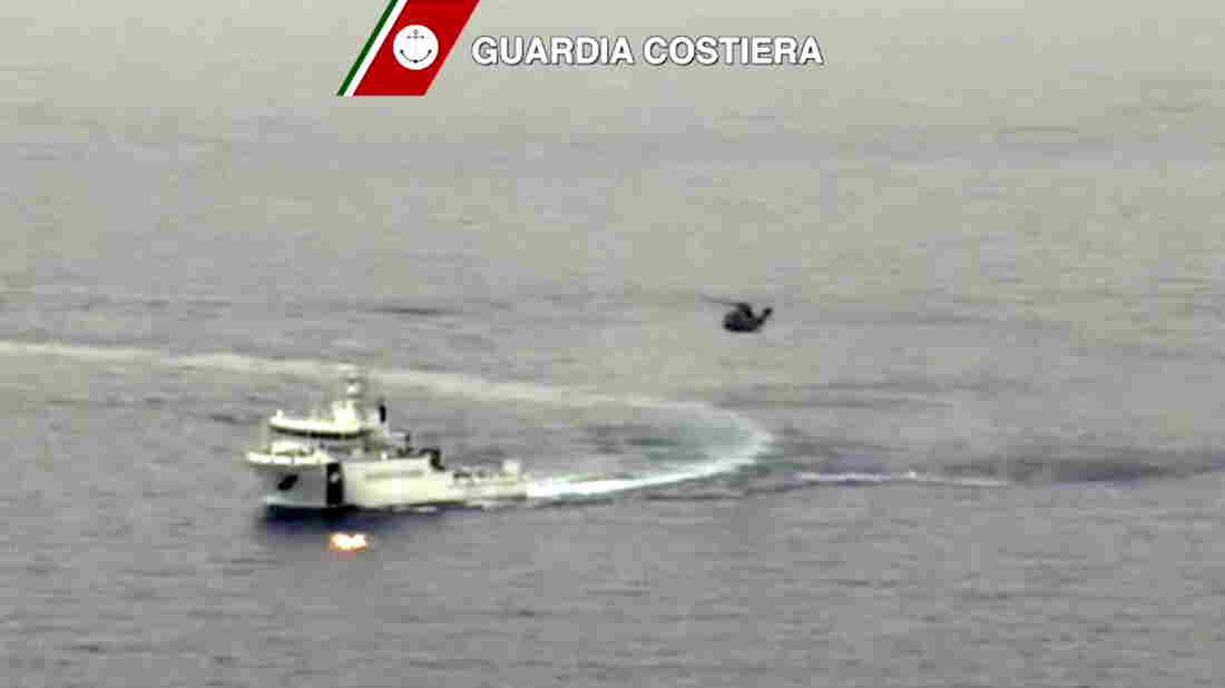 An Italian coast guard vessel took part in a large search and rescue operation Sunday after a boat carrying migrants capsized overnight.
