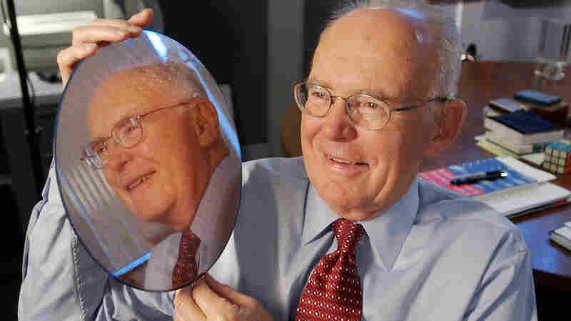Intel Corp. co-founder Gordon Moore holds up a silicon wafer at Intel headquarters in Santa Clara, Calif., in 2005. Moore first noted 50 years ago that the number of transistors that can be packed into a computer chip doubles about every two years. That observation, called Moore's Law, has been the basis for the entire digital revolution.