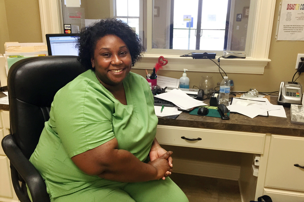 LaTasha Perry says she couldn't afford the health plan offered by the community health center where she works. But with a subsidized plan, she has insurance and money left over