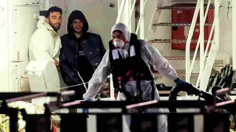 Mohammed Ali Malek, left, and Mahmud Bikhit, right, were identified by survivors as the captain and a crew member of the ship that sank in the Mediterranean this weekend. They're seen here shortly before an Italian Coast Guard ship brought hem to Catania, Sicily.