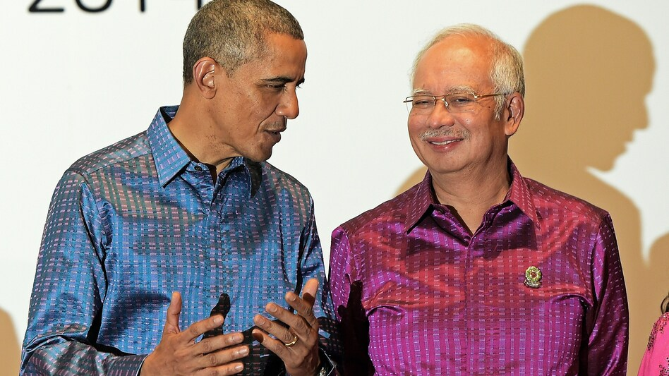 President Obama talks with Malaysian Prime Minister Najib Razak at the East Asia Summit in Myanmar in November. Obama is trying to strike a 12-country Trans-Pacific Partnership, which would include Malaysia. (Christophe Archambault/AFP/Getty Images)
