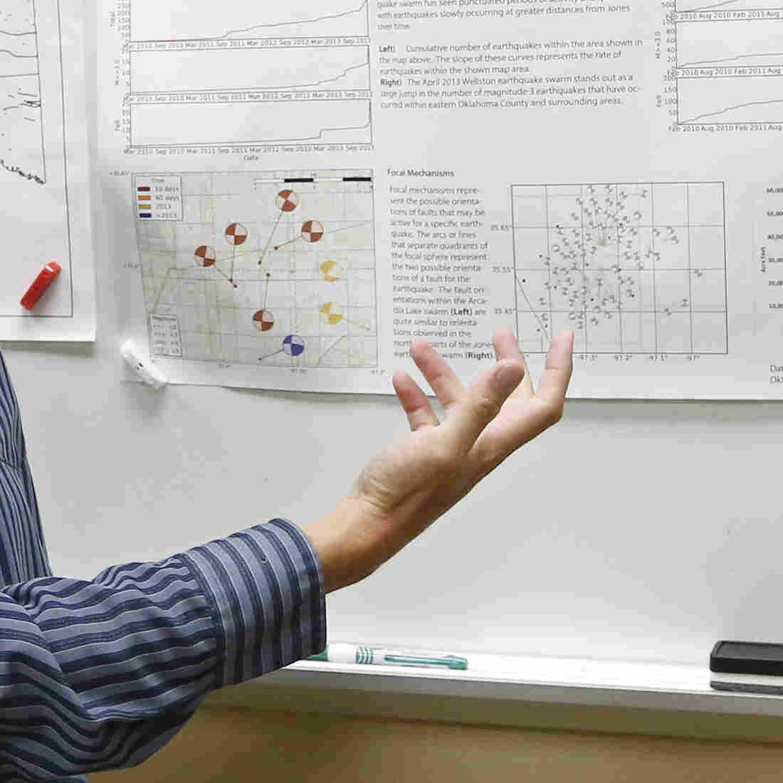 Austin Holland, research seismologist at the Oklahoma Geological Survey, gestures to a chart of Oklahoma earthquakes in June 2014 as he talks about recent earthquake activity at his offices at the University of Oklahoma in Norman, Okla. The state had three times as many earthquakes as California last year.