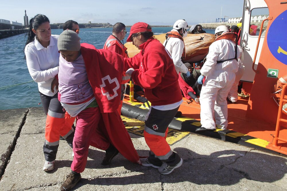 Many pregnant women and children are among the migrants from the Middle East and Africa seeking a better life in Europe. Here, Spanish Red Cross members help a pregnant woman rescued from a small boat traveling near Tarifa port in Cadiz, southern Spain, on Feb. 27.