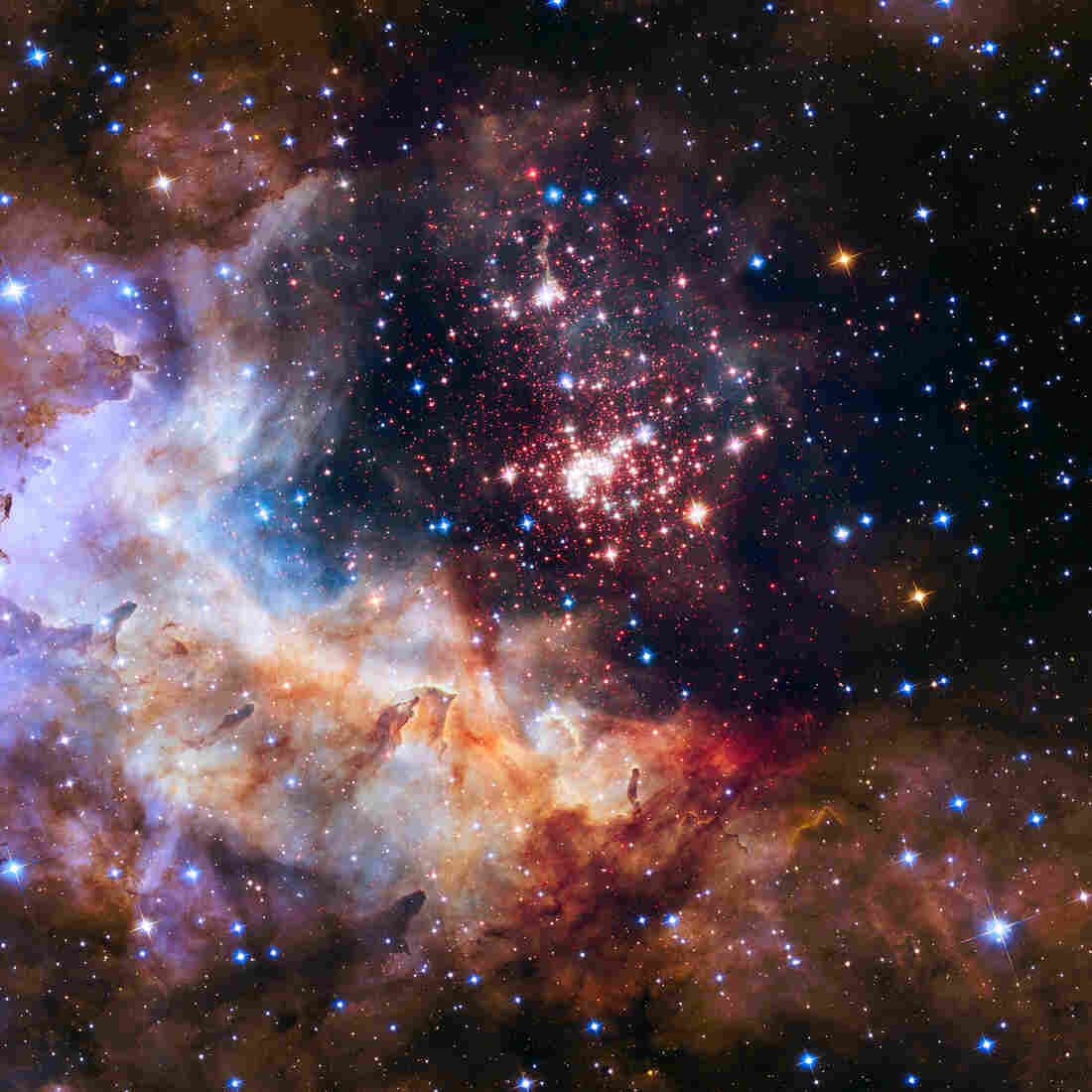 A giant cluster of about 3,000 stars called Westerlund 2. The cluster resides in a raucous stellar breeding ground known as Gum 29, located 20,000 light-years away in the constellation Carina.