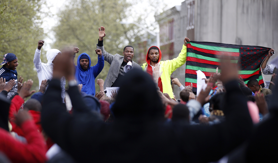 Marchers gather at the Baltimore Police Department's Western District police station during a march for Freddie Gray on Wednesday in Baltimore. (Alex Brandon/AP)