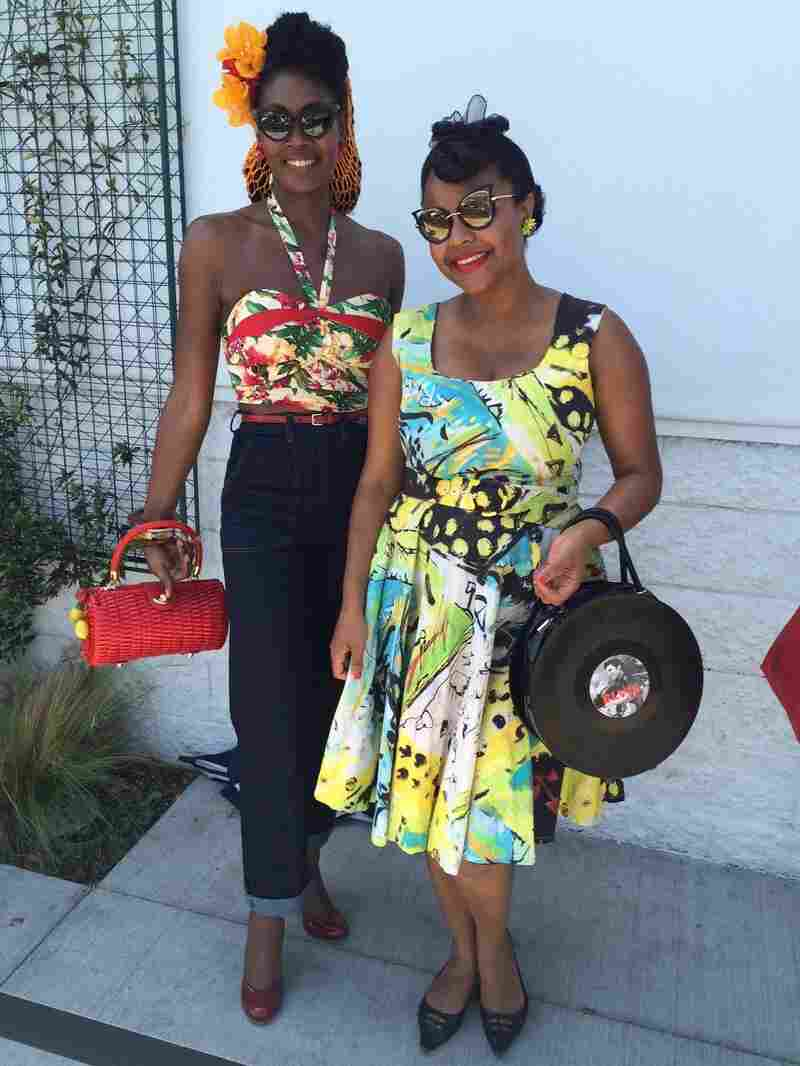 """For some shoppers, like Angelique Noire (left) and Jenny Rieu, """"ethical fashion"""" means lining up for a massive vintage clothing sale."""