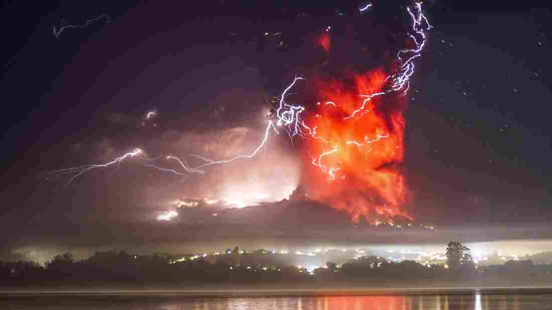 The view from Puerto Varas shows a high column of ash and lava spewing from the Calbuco volcano in the darkness of early Thursday. The Calbuco volcano erupted Wednesday, spewing a giant plume of ash high into the sky.