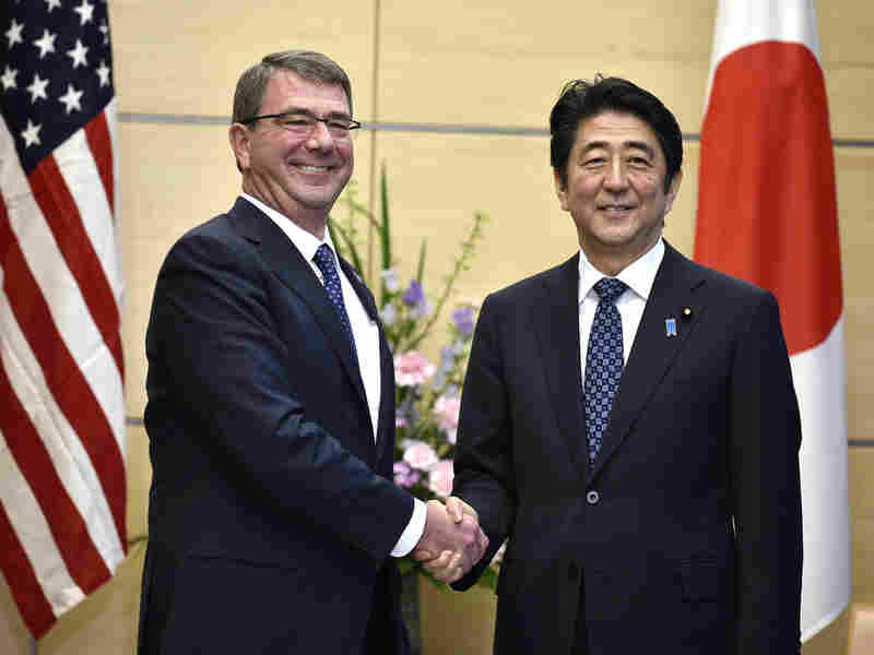 Japanese Prime Minister Shinzo Abe with U.S. Defense Secretary Ash Carter earlier this month in Tokyo. Abe's visit to the U.S. this week features an agreement for the Japanese military to have a more active role.