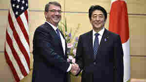Japan's Prime Minister Shinzo Abe with U.S. Defense Secretary Ash Carter earlier this month in Tokyo. Abe's visit to the U.S. this week features an agreement for the Japanese military to have a more active role.