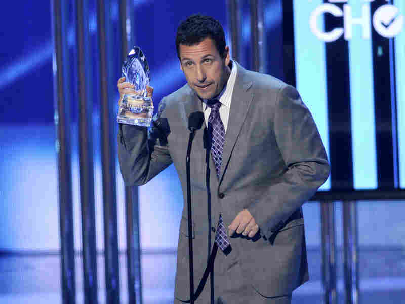 Adam Sandler accepts the award for favorite comedic movie actor at the People's Choice Awards at the Nokia Theatre on Jan. 7 in Los Angeles.