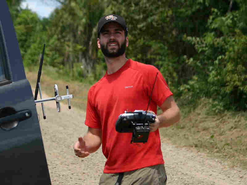 Max Messinger of Wake Forest University flies a drone in the Peruvian Amazon.