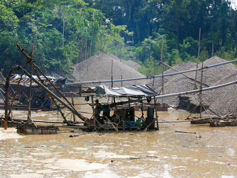 In the Madre de Dios region of eastern Peru, miners use hoses to blast away the soil in the rain forest and then sift the sediment for gold.