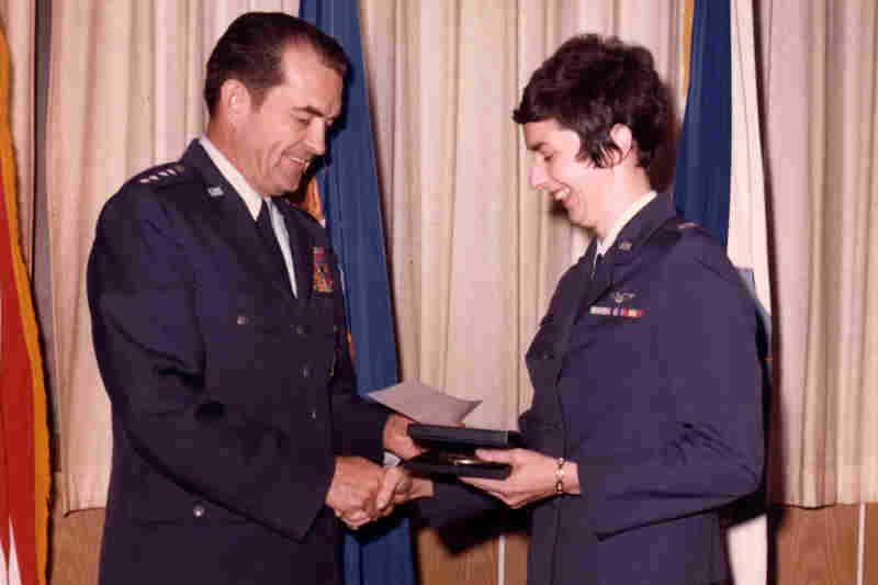 Regina Aune, chief medical officer aboard the flight and now a colonel, is presented with the Cheney Award by Gen. David Jones, chief of staff of the Air Force, in 1976.