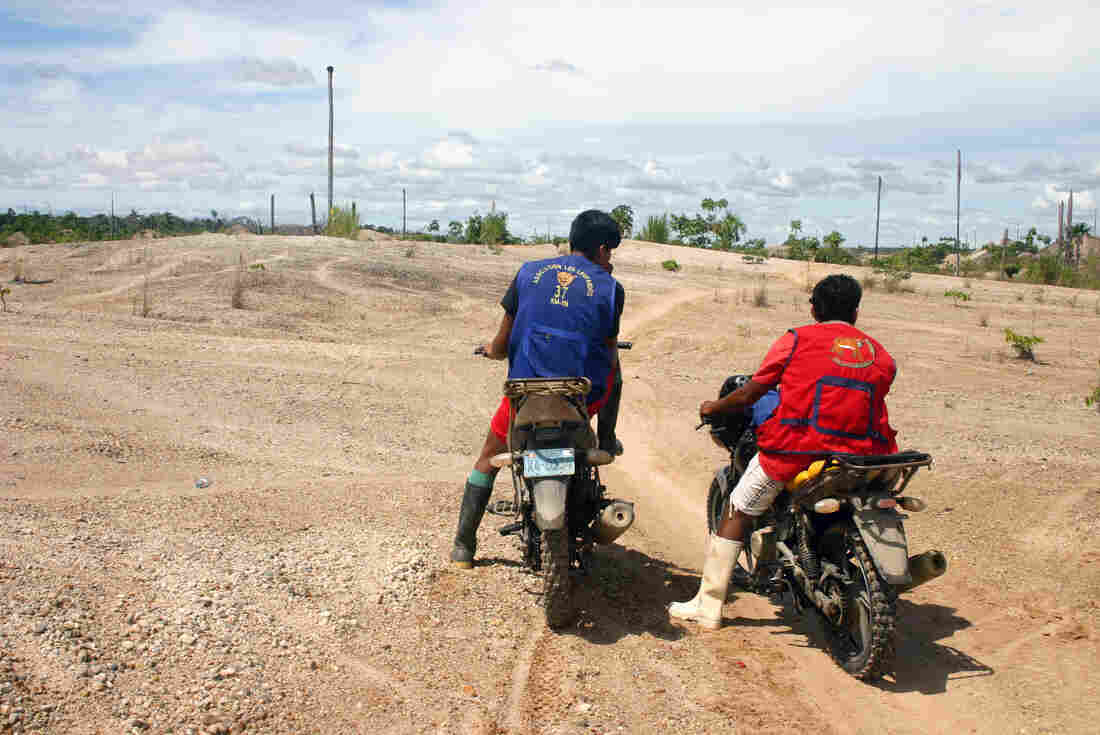 Motorcycle taxis like these are the only way to enter the La Pampa mining zone. They ferry people and mining supplies over narrow trails in the jungle.