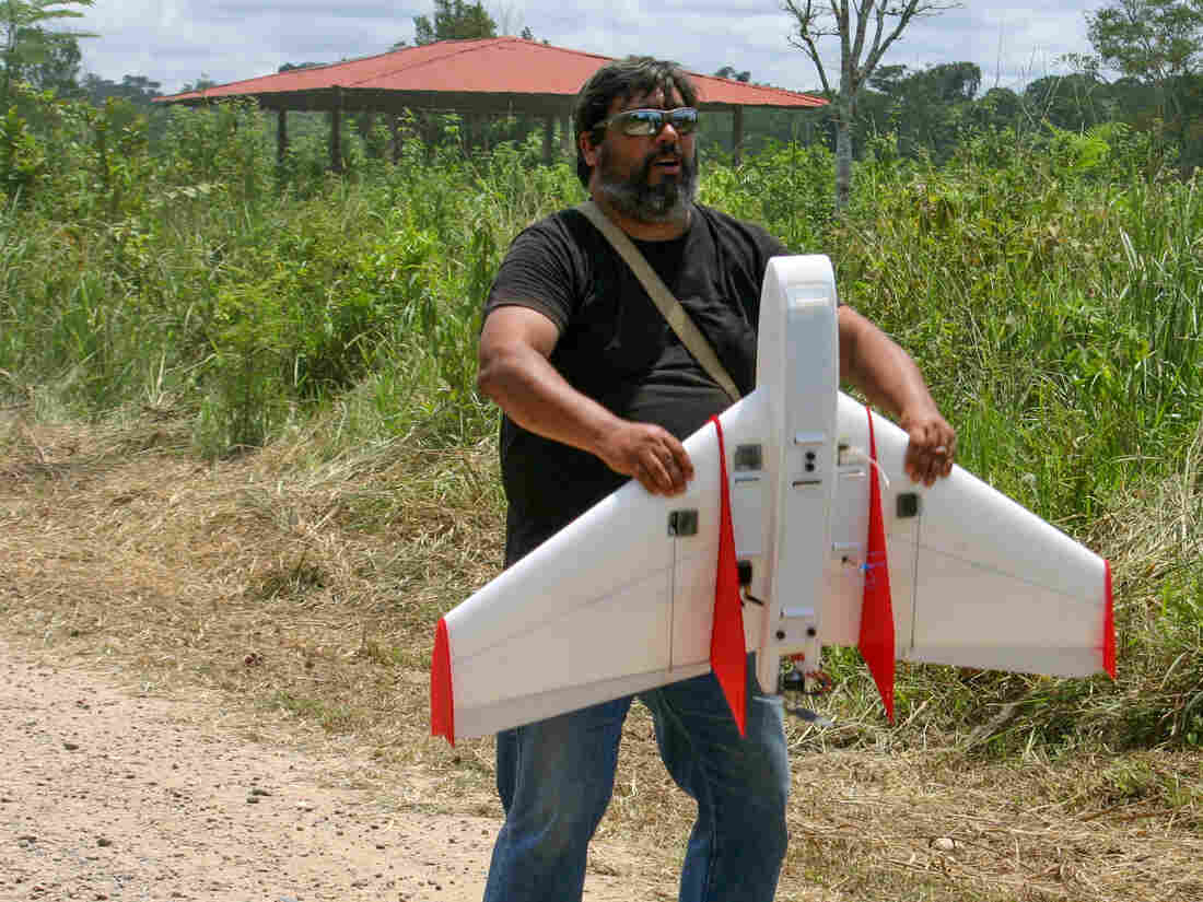 A man and his drone: Carlos Casteneda of the Amazon Basin Conservation Association prepares to launch one of his plastic foam planes.