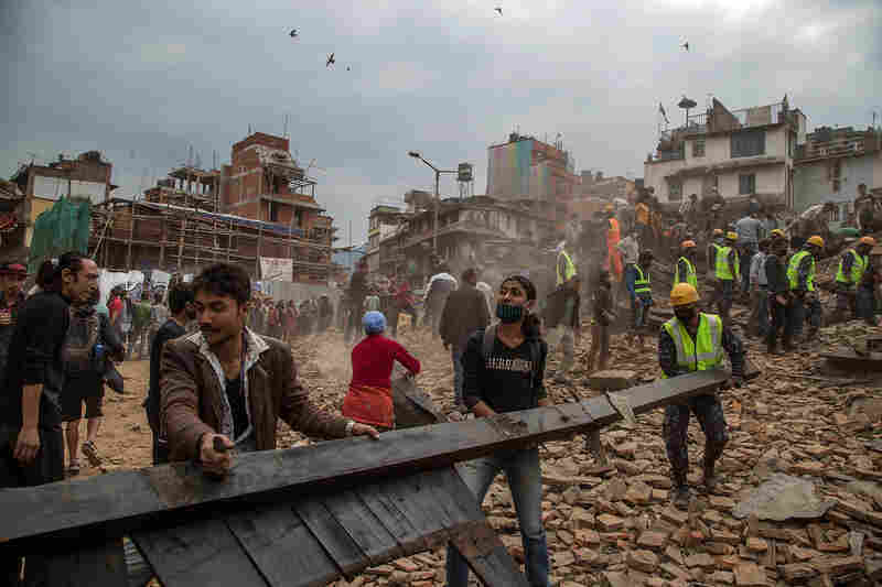 Emergency rescue workers clear debris in Basantapur Durbar Square while searching for survivors in Kathmandu, Nepal, Saturday.