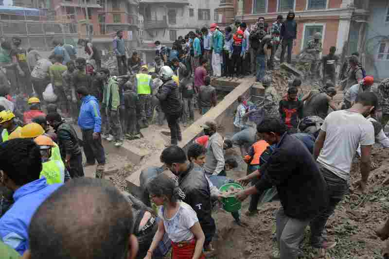People clear rubble in Kathmandu's Durbar Square, a UNESCO World Heritage Site that was severely damaged by the earthquake.