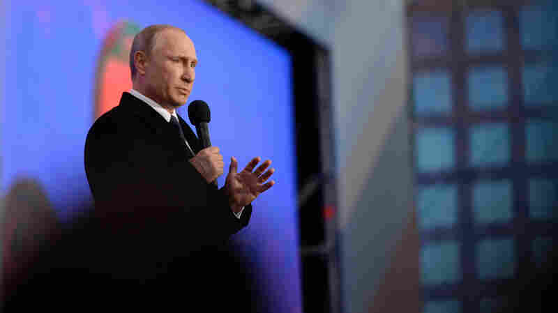Russian President Vladimir Putin speaks at a celebration to mark the first anniversary of Crimea's incorporation into Russia, in Moscow, on March 18.
