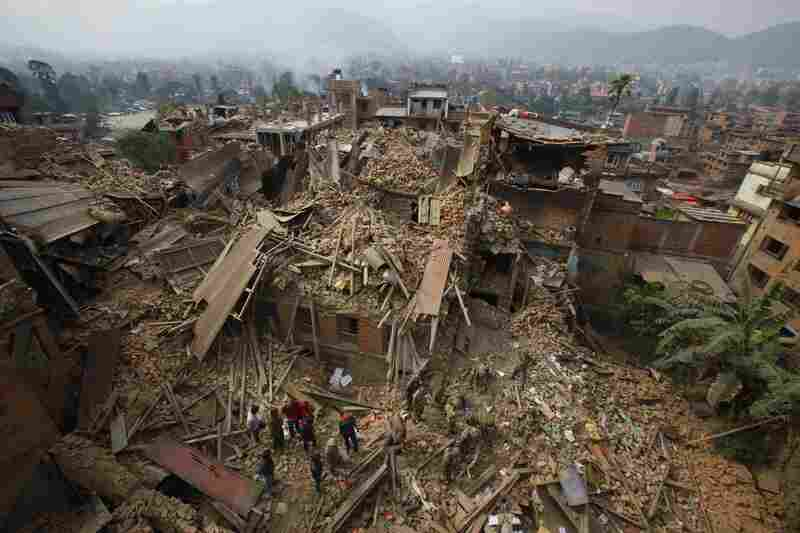 Rescue workers remove debris as they search for victims of earthquake in Bhaktapur, near Kathmandu, on Sunday.