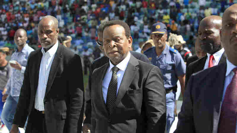 Zulu King Goodwill Zwelithini, center, arrives at a Zulu gathering at a stadium in Durban, South Africa. Six people have died in anti-immigrant violence in the city in recent weeks, and another death has been reported in Johannesburg; Zwelithini is accused of inciting the attacks with incendiary comments, but says his remarks were taken out of context.