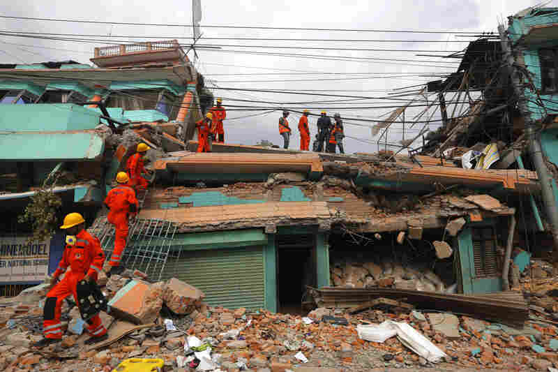 India's National Disaster Response Force personnel look for survivors in a building, in Kathmandu, Nepal on Sunday.