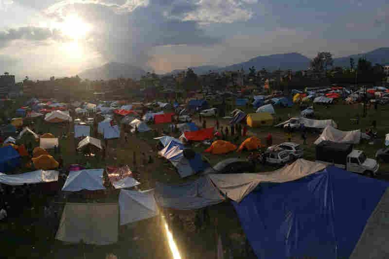 Nepalese residents set up tents in an open field at Chuchepati area in Kathmandu, Nepal.