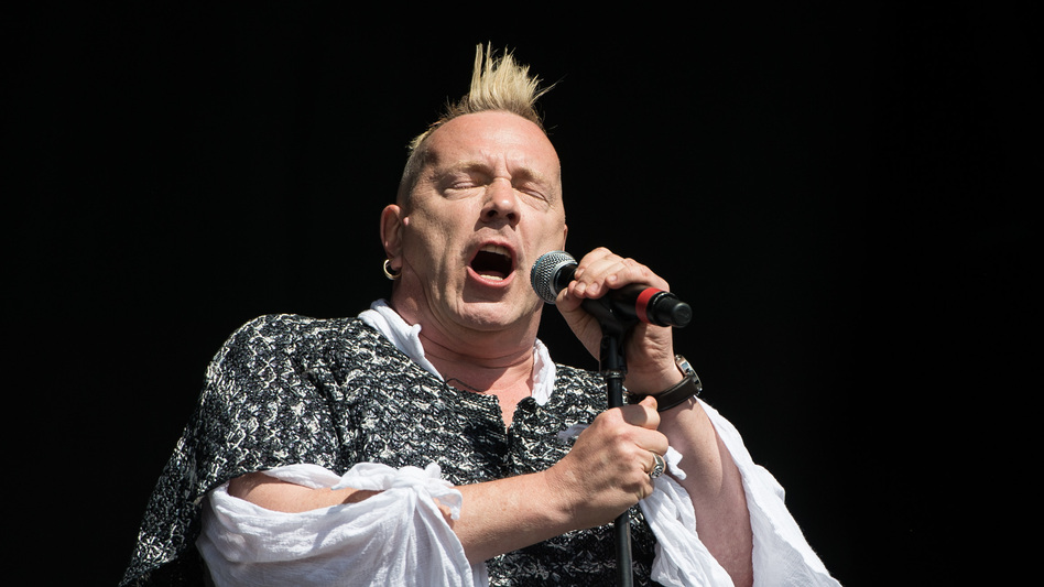 "John ""Johnny Rotten"" Lydon, seen here with his band Public Image Ltd at the 2013 Glastonbury Festival, is the former frontman of the Sex Pistols. (Getty Images)"