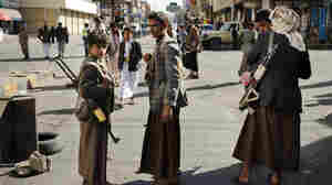 A young boy carries a rifle in Yemen's capital Sanaa. When photographer Alex Potter arrived in Yemen in 2012, men had guns but rarely displayed them publicly. Now, as the country has collapsed into civil war, men and boys are often armed.