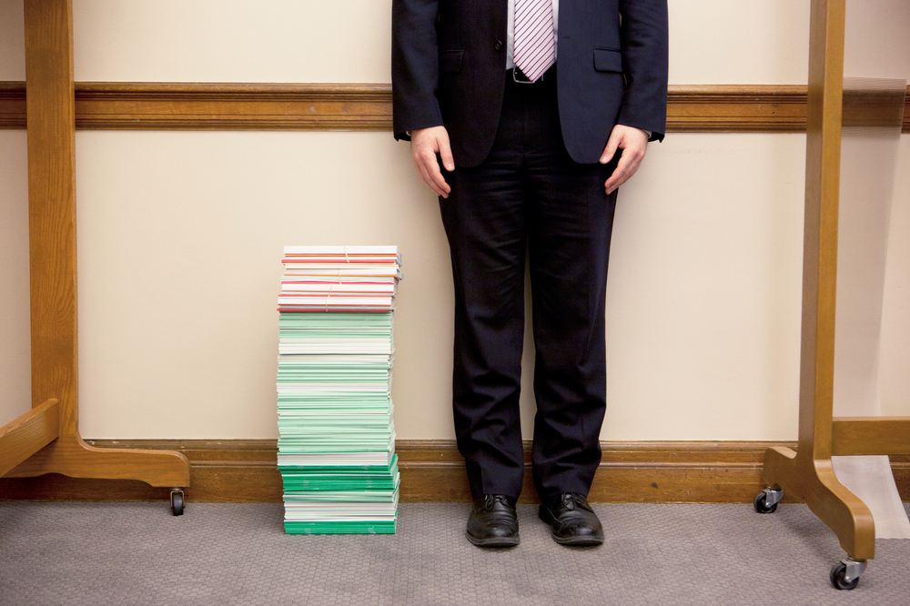 The stack of amicus briefs filed as of April 9 reached past the knee of NPR legal affairs intern Anthony Palmer. The briefs cost, on average, an estimated $25,000 to $50,000.