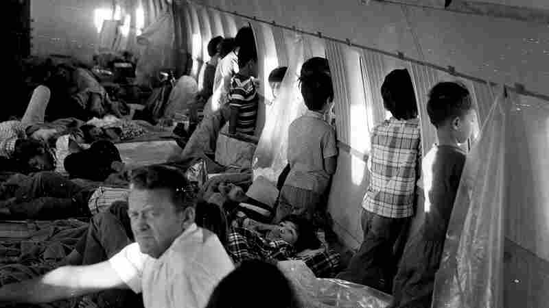 Children aboard this World Airways DC-8 jet on April 2, 1975, were evacuated from Vietnam shortly before the fall of Saigon and just two days before the first official Operation Babylift flight. Among the children, was 12-year-old Thanh Jeff Ghar (center, lying down in front of a window). He says being brought to the U.S. gave him opportunities he never would have had if he remained in Vietnam.