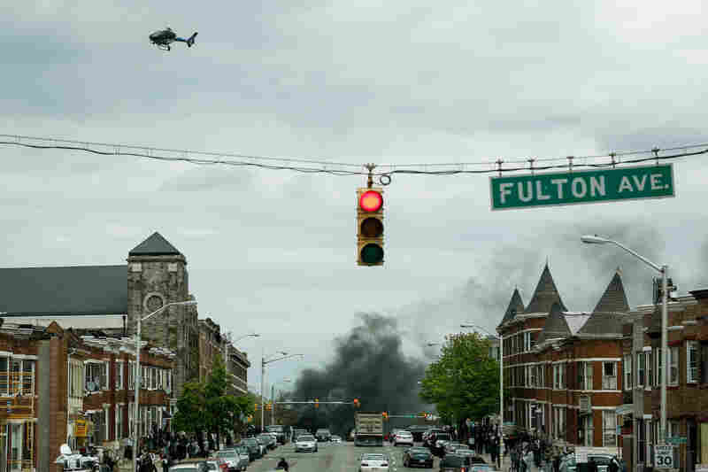 Smoke billows at the intersection of Pennsylvania Avenue and North Avenue (seen from Fulton Ave), on Monday in Baltimore. Riots have erupted in Baltimore following the funeral service for Freddie Gray, who died last week while in Baltimore Police custody.