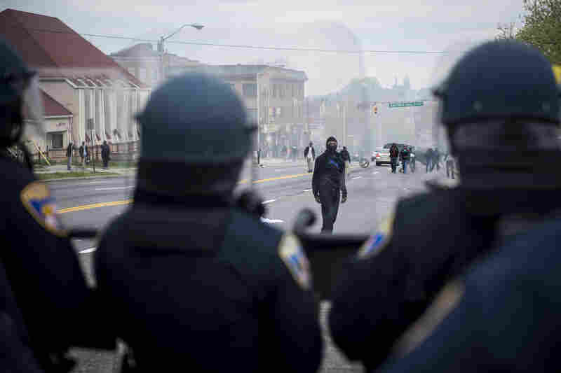 Police in riot gear block Reisterstown Road near Mondawmin Mall in Baltimore on Monday.