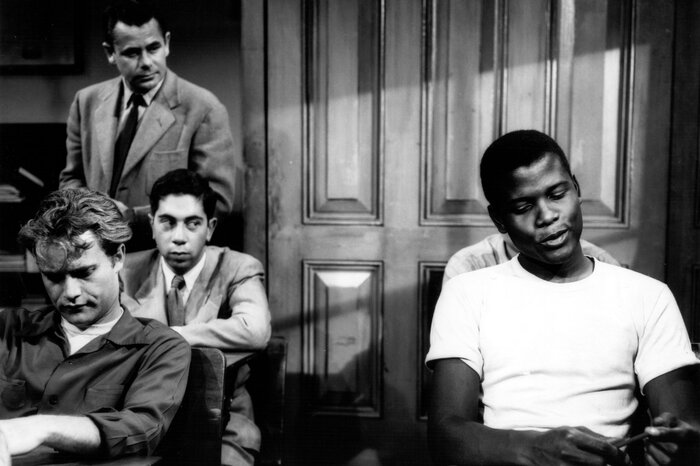 Sidney Poitier (right) and Glenn Ford (standing) in the 1955 film Blackboard Jungle.