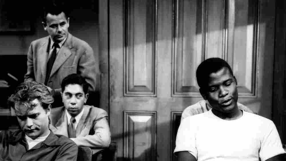 Sidney Poitier (right) and Glenn Ford (standing) in the 1955 film, Blackboard Jungle.