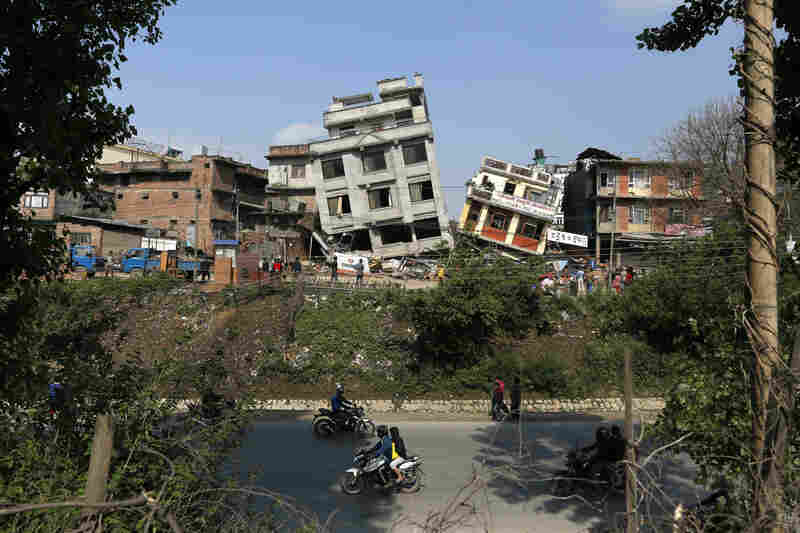 Damaged buildings lean to their sides in Kathmandu. The magnitude-7.8 earthquake shook Nepal's capital and the densely populated Kathmandu Valley, causing extensive damage with toppled walls and collapsed buildings.