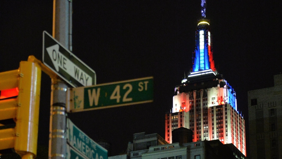 Like the Empire State Building in New York, Clinton's logo is changing appearance to say something about the topics of the day or to tailor to key constituencies. (Mladen Antonov/AFP/Getty Images)