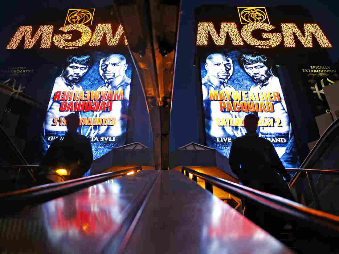 The MGM Grand marquee is reflected in an escalator with advertising for the Mayweather Pacquiao fight, which will take place Saturday in Las Vegas.