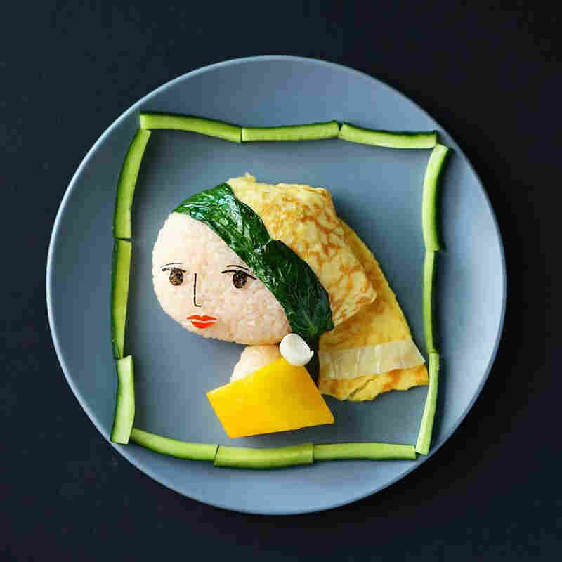 Samantha Lee is a mother based in Malaysia who makes edible re-creations of everything from Totoro to Tinker Bell. Here, her take on Vermeer's Girl with a Pearl Earring, made of onigiri (white rice wrapped in nori, or seaweed), with cabbage and choy sam, an omelet and yellow capsicum. The lips and earring are crafted from crab stick.
