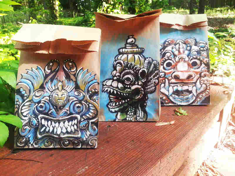 Three of Benson's lunch bag paintings based on Balinese sculpture