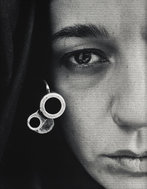 Click here to see the tiny script printed on the face of the veiled warrior in Shirin Neshat's 1996 work Speechless.