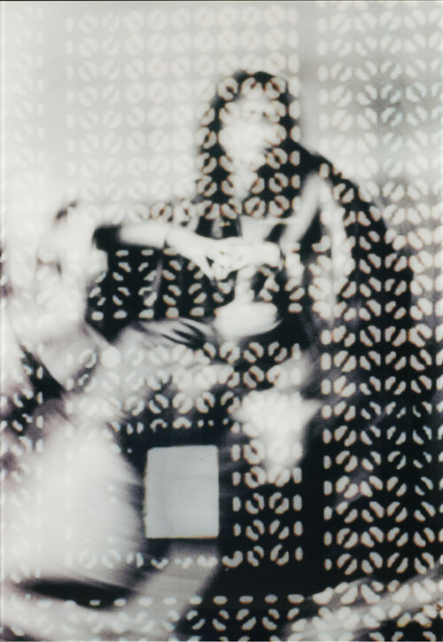 "Curator Linda Komaroff says the woman in Susan Hefuna's Woman Behind Mashrabiya I is ""very mysterious — and deliberately so."""