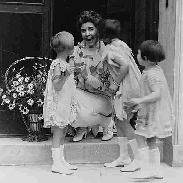 First lady Grace Coolidge receives a May basket from young children in 1927.