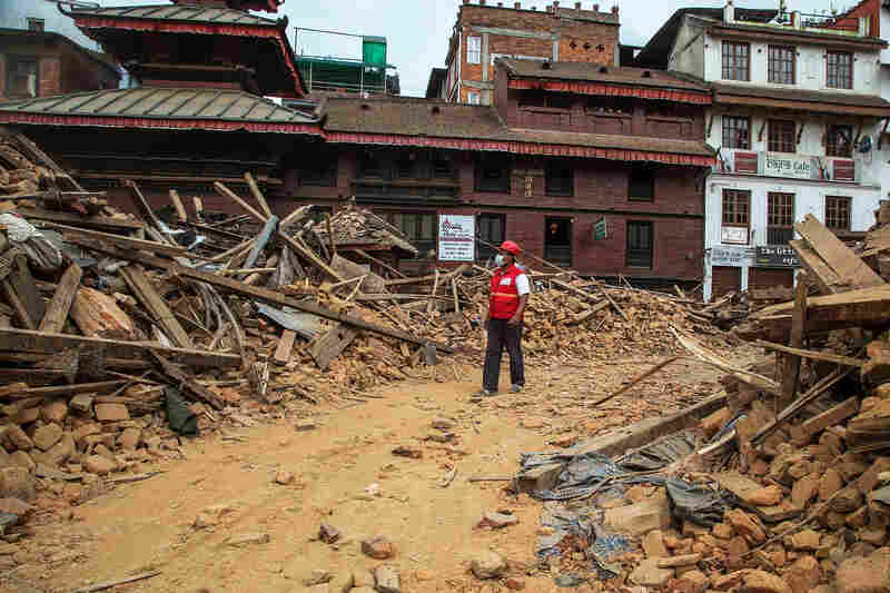 An earthquake emergency team member walks through debris from one of the UNESCO World Heritage site temples in Basantapur Durbar Square in Kathmandu, Nepal, on Tuesday. More than 5,000 people are confirmed dead from Saturday's earthquake.