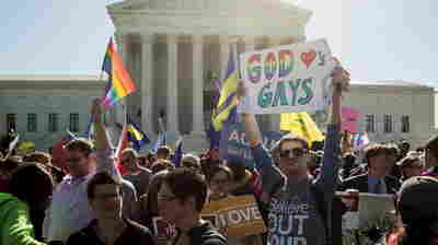 Supporters of same-sex-marriage rally in front of the Supreme Court before the justices heard arguments Tuesday. The hearing was disrupted by an opponent of gay marriage who yelled loudly in the courtroom before — and while — he was removed.