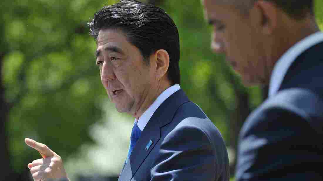 Japan's Prime Minister Shinzo Abe speaks during a joint press conference at the White House with President Obama on Tuesday. Abe is urging U.S. lawmakers to approve a trans-Pacific trade deal.