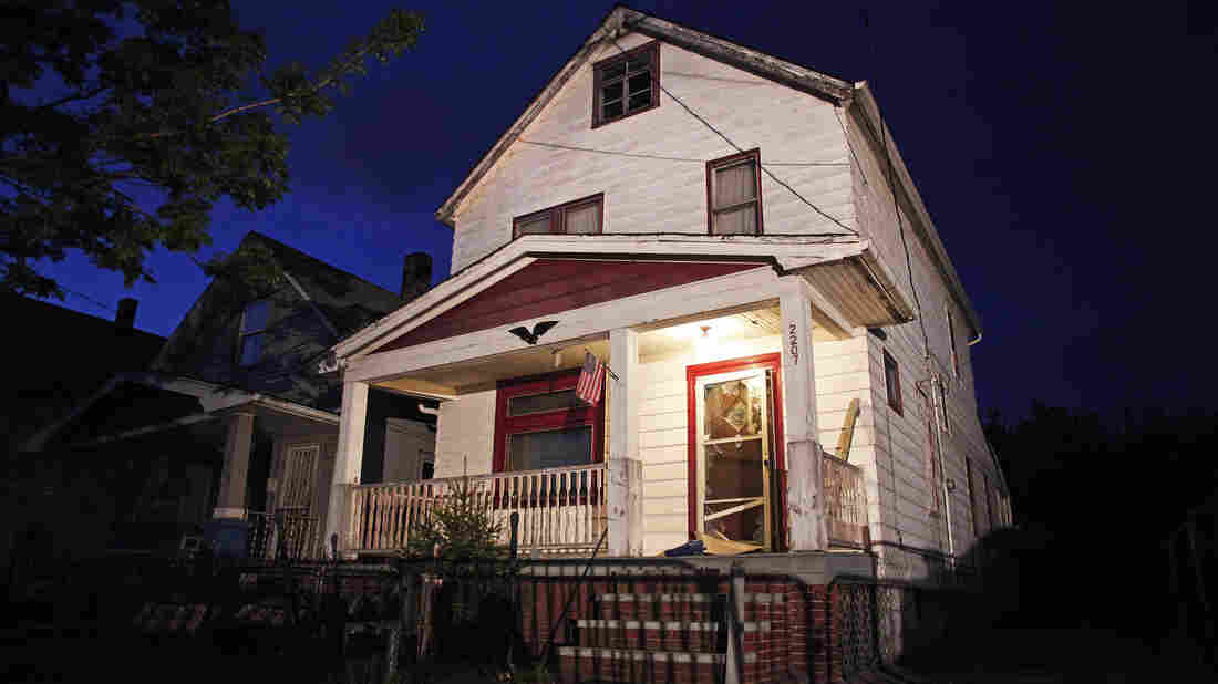 House of horrors: The exterior of the Cleveland house where Amanda Berry, Gina DeJesus and Michelle Knight were held captive.